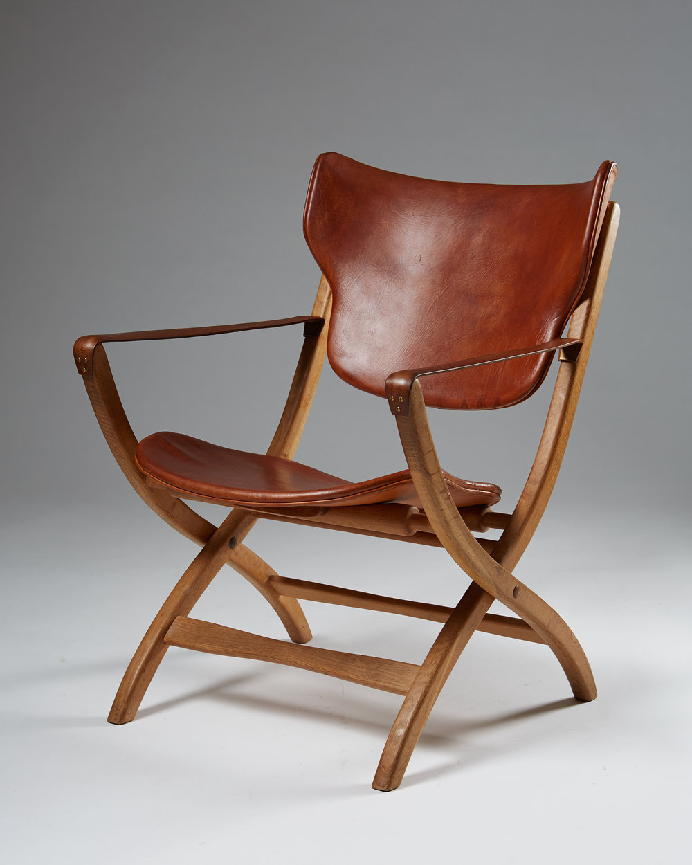 Poul Hundevad  Egyptian Chair Denmark, 1950's Oak and natural leather 80 x 54 x 68 cm Seat height: 38 cm
