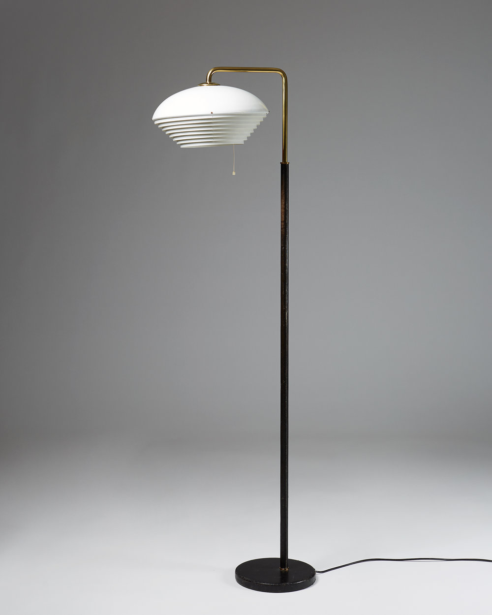 Alvar Aalto  Floor lamp A811 Finland, 1950's Cast iron, brass, lacquered metal and leather. Height: 160 cm