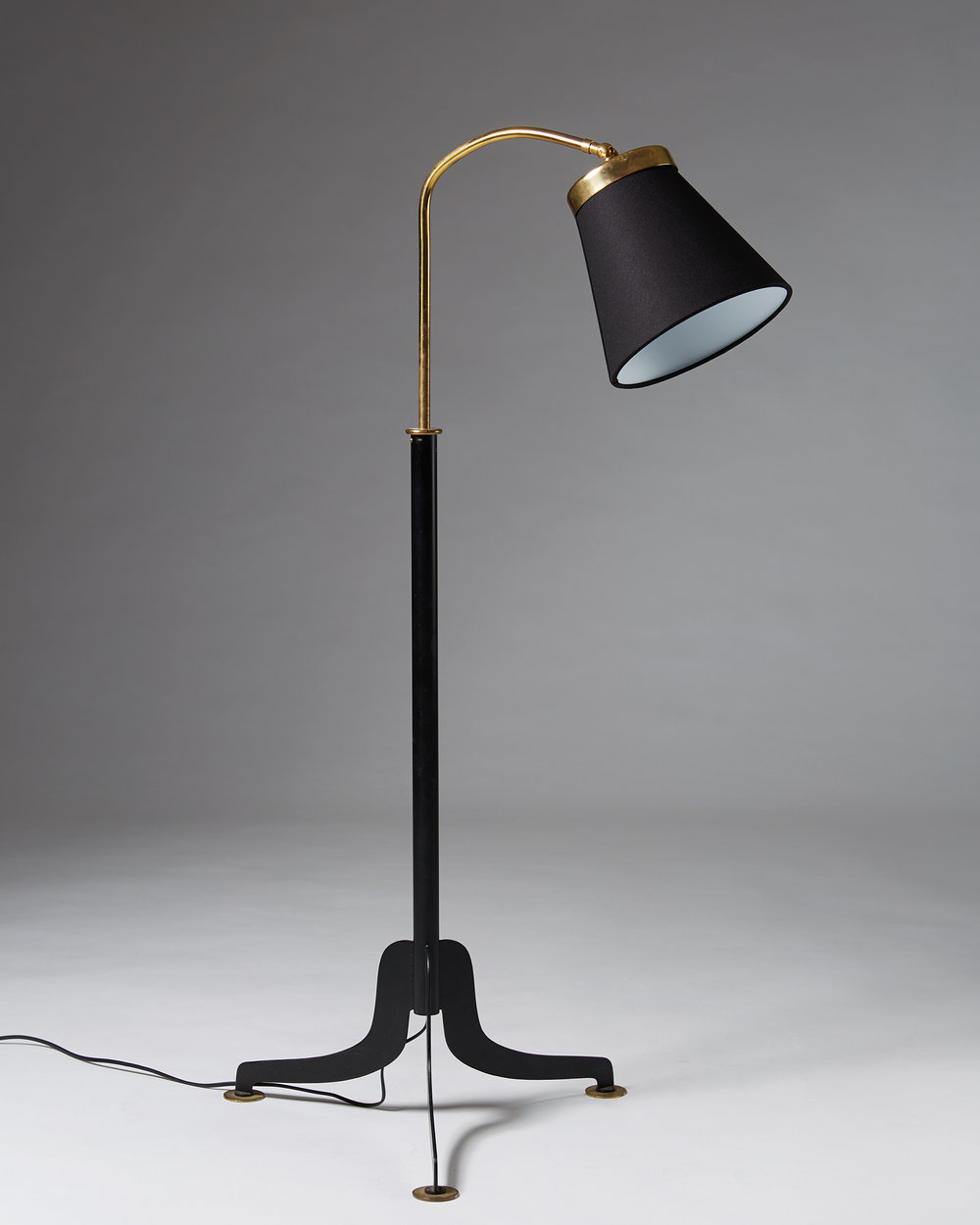 Josef Frank  Floor lamp Sweden, 1950's Polished and lacquered brass with black textile shade.