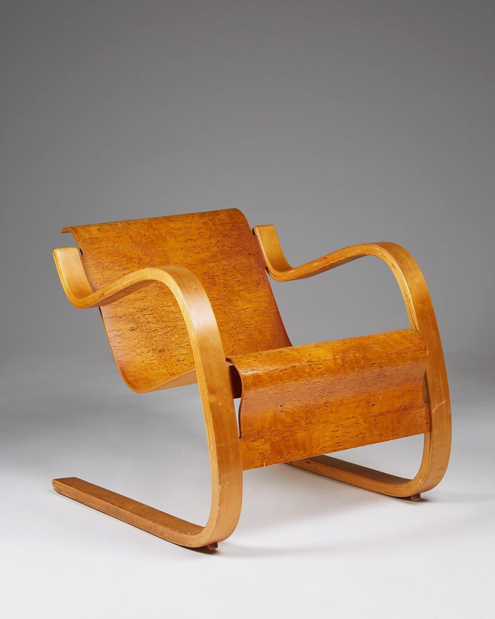 Alvar Aalto  Armchair number 31 Finland, 1931-1932 Birch and Karelian birch. 61 x 61 x 70 cm Seat: from 36 to 24 cm