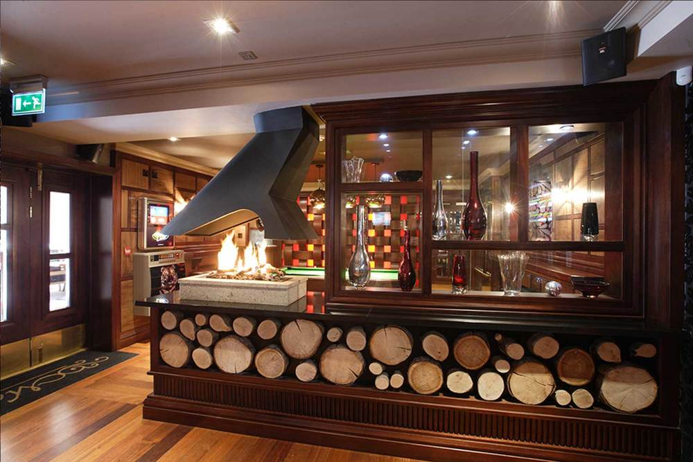 Malone's Irish Pub - wooden log interior design