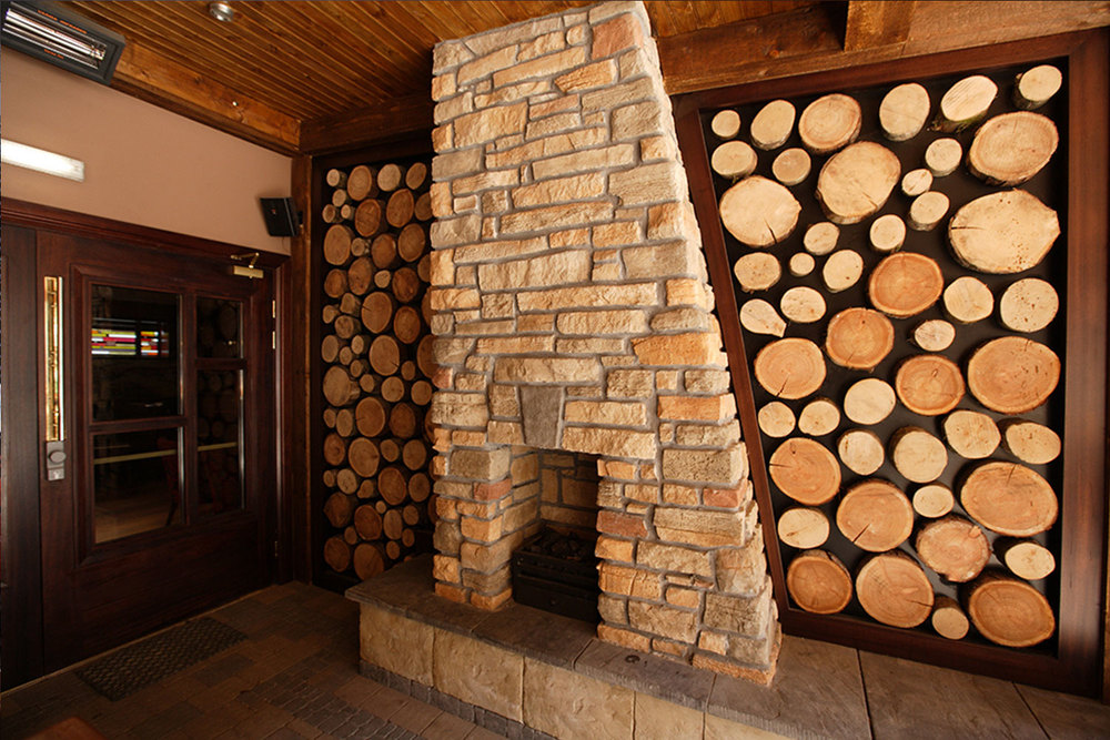 Malone's Irish Pub - wooden log walls and fireplace interior design