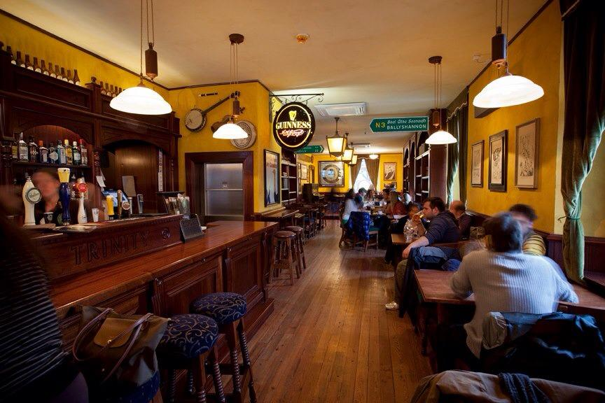 Trinity Irish Pub design - interior view of bar and seating