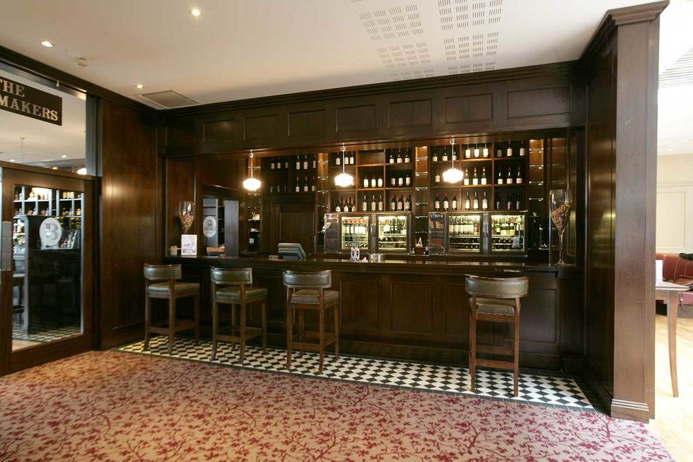 Bewley's Hotel Bar design - interior bar with dark wood