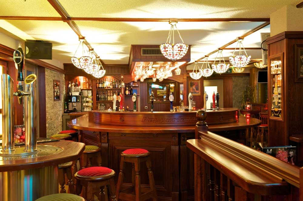 Papperla authentic Irish bar design - interior view of wooden, round bar