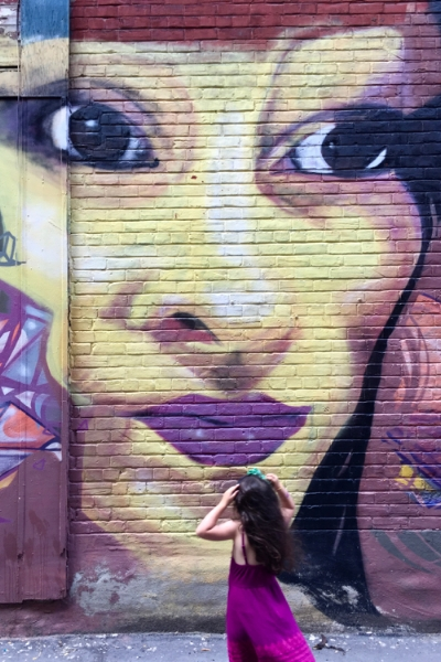 Talula admiring a downtown alley mural