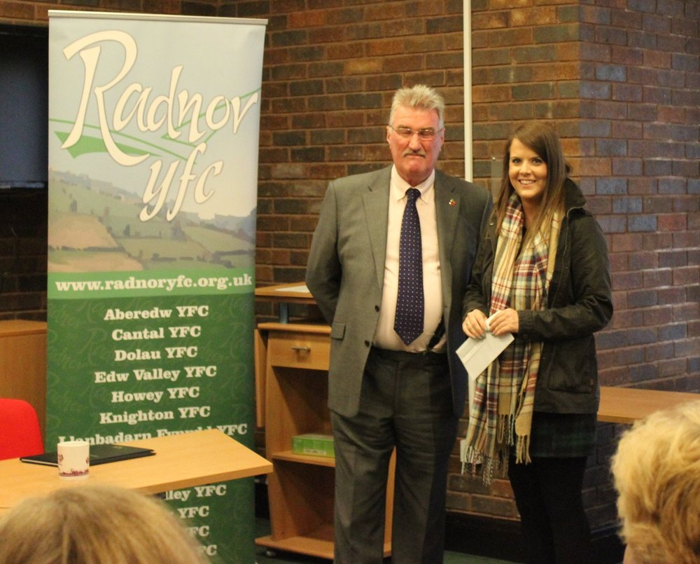 Penybont YFC Chairman Aj Powell accepting the £50 Bursary from judge Mal Thomas