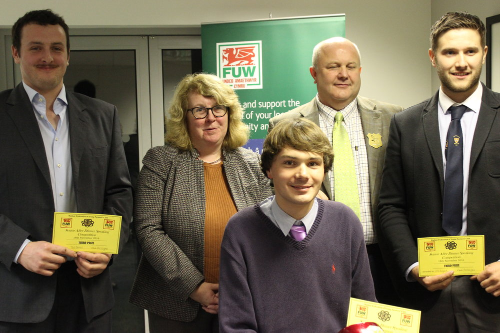 3rd Place in the After Dinner Speaking competition Ted Davies, James Mitchell & Will Rogers, Presteigne YFC with judges Stuart & Karen Anthony.