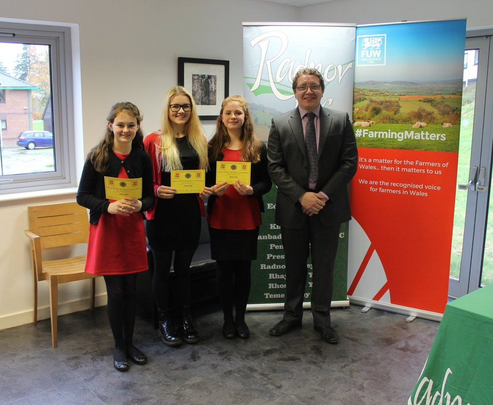 Fenella Price, Eli Hulin Taylor & Carys Moore, Edw Valley YFC with judge Hefin Jones gaining 3rd prize.