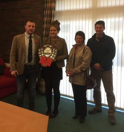 Gemma Price, Llanbadarn Fynydd YFC with Judges Owen Davies, Elaine Blair & Adam Rees with the Junior Member of the Year shield.
