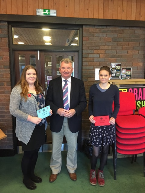 Natalie Wood, Knighton YFC & Mollie Hooper, Presteigne YFC with judge Clive Alexander in the Situation Vacant competiton.