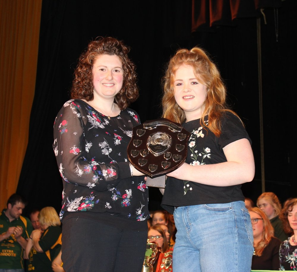 Molly Price being presented the 'John Thompson Shield' for best vocalist by Avril Hardwick, Barclays