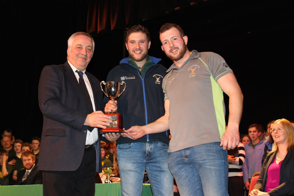 Will Rogers & Owen Davies, Presteigne YFC being presented the 'Alice Ellard Award' for best duo by David Powell, FUW