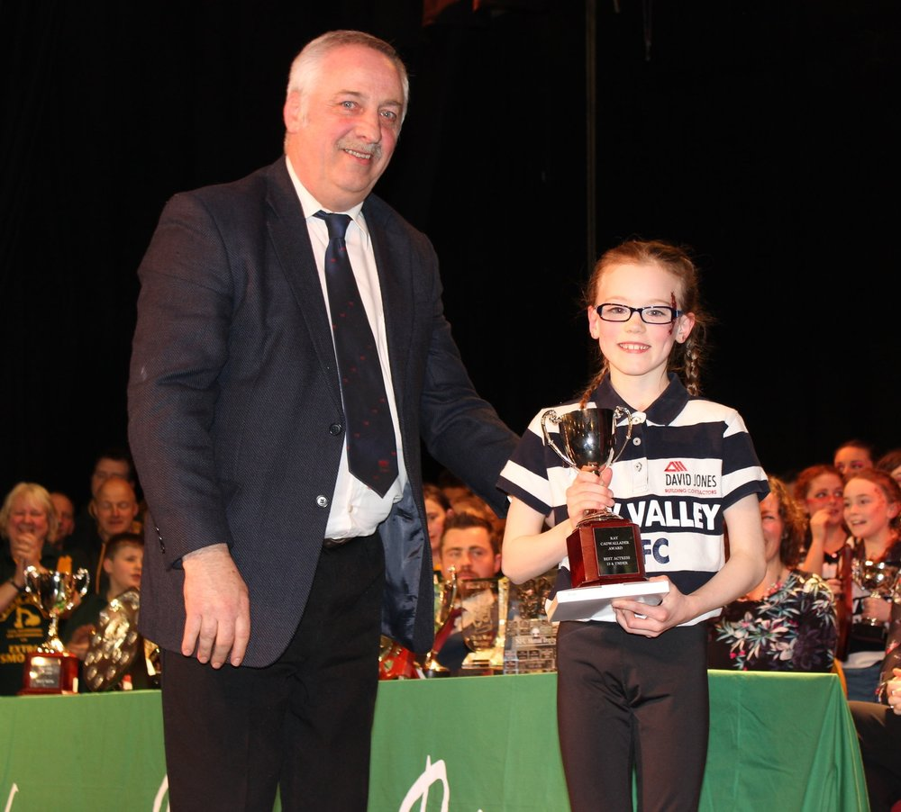 Hali Rae Morris, Edw Valley YFC being presented with the 'Ray Cadwallder Award' for best Actress Under 13 by David Powell, FUW
