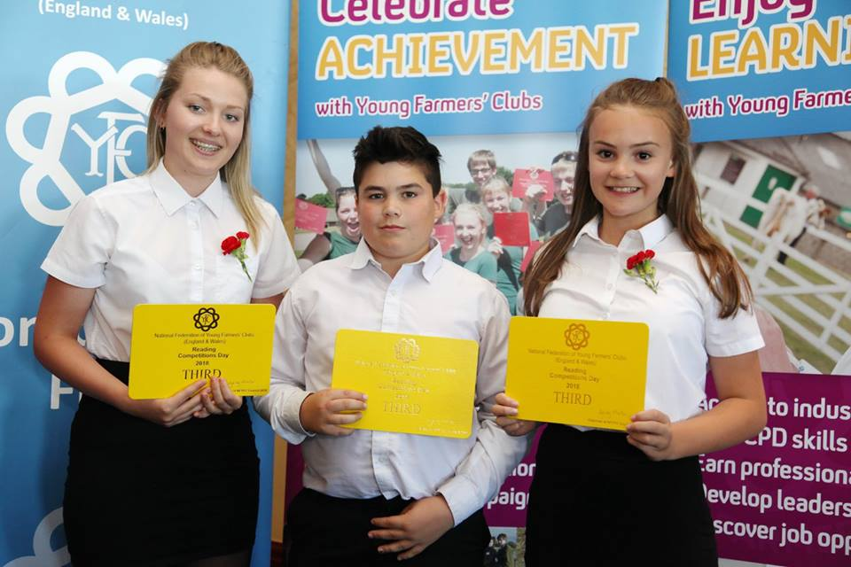Joanna Thomas, Cantal YFC, William Lewis< Cantal YFC & Katie Hammonds, Edw Valley YFC in the Junior Reading Compeitition.