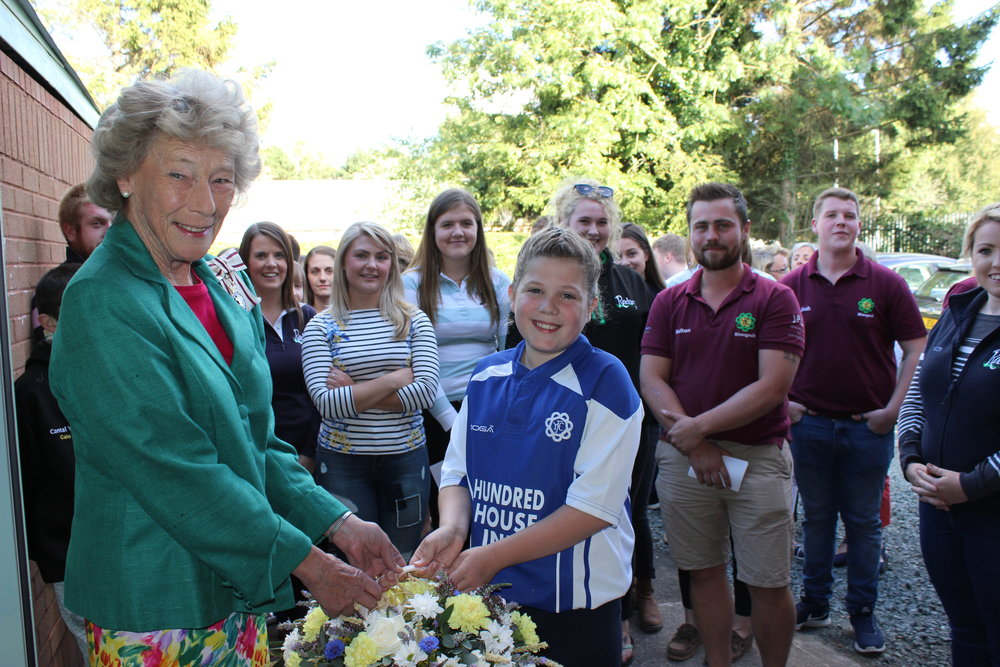Youngest member Seren Price presenting Honourable Mrs Legge-Bourke with flowers.