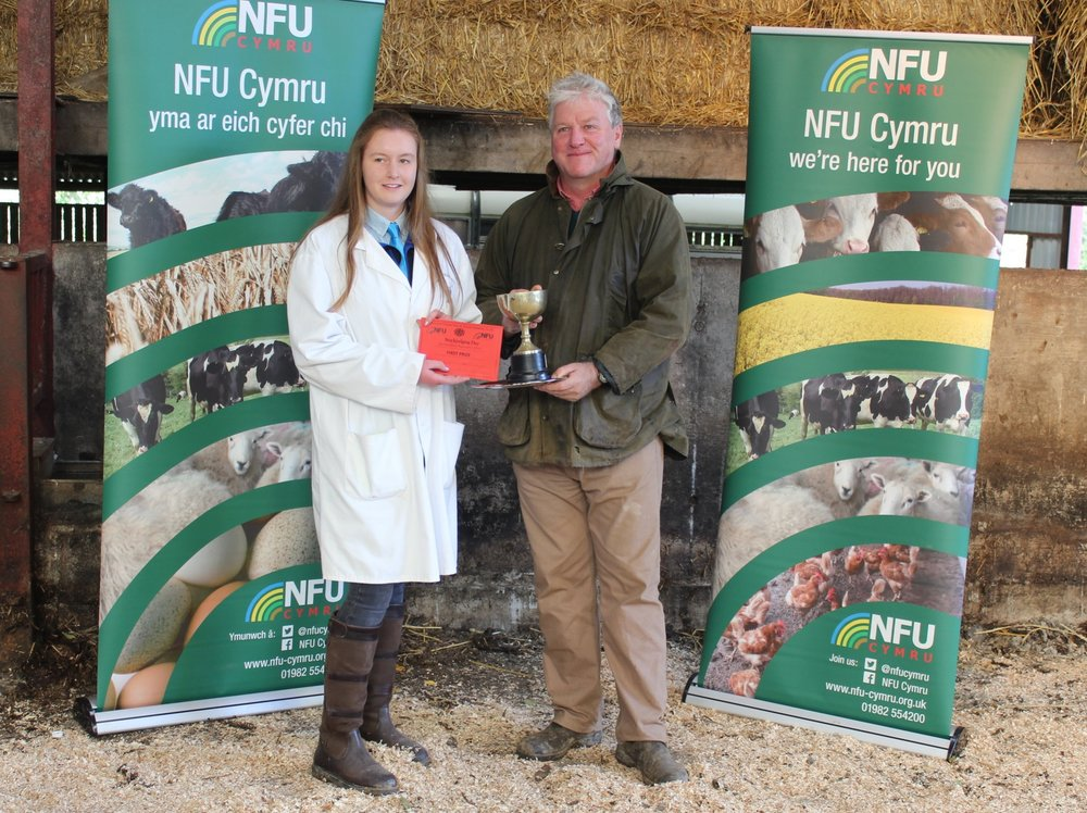 Lucy Griffiths, Presteigne YFC with Stockjudging Day host David Lewis winning Junior Stockman of the Year.