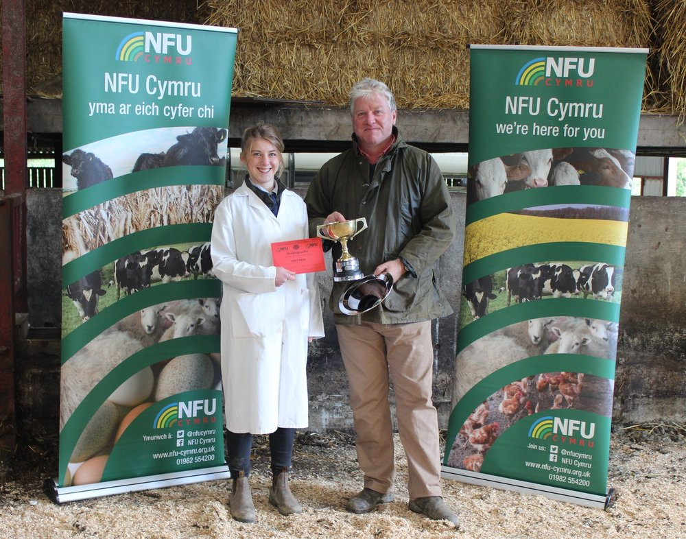 Elizabeth Swancott, Teme Valley YFC with Stockjudging Day host David Lewis winning Senior Stockman of the Year.