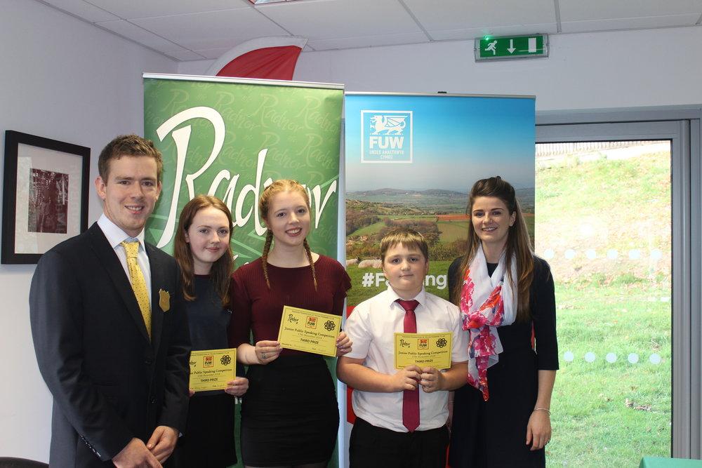 Becky Duggan & Amy Edwards, Penybont YFC & William Goodwin Edwards, Llanbadarn Fynydd YFC gaining third place in the Junior Public Speaking competition with judges Owen Morris & Lucy Bright.