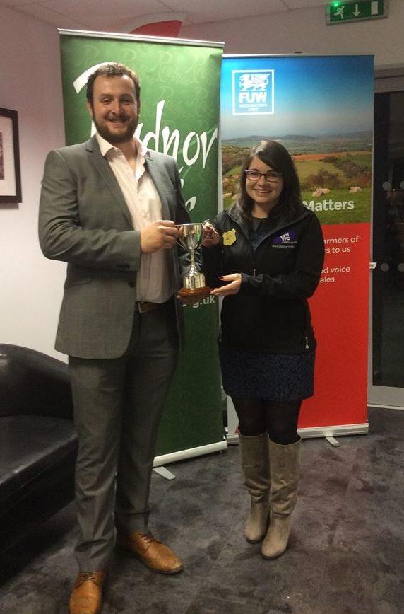 Ted Davies, Presteigne YFC being presented the Owen Duggan Memorial Trophy for best individual, by jugde Katie Davies.