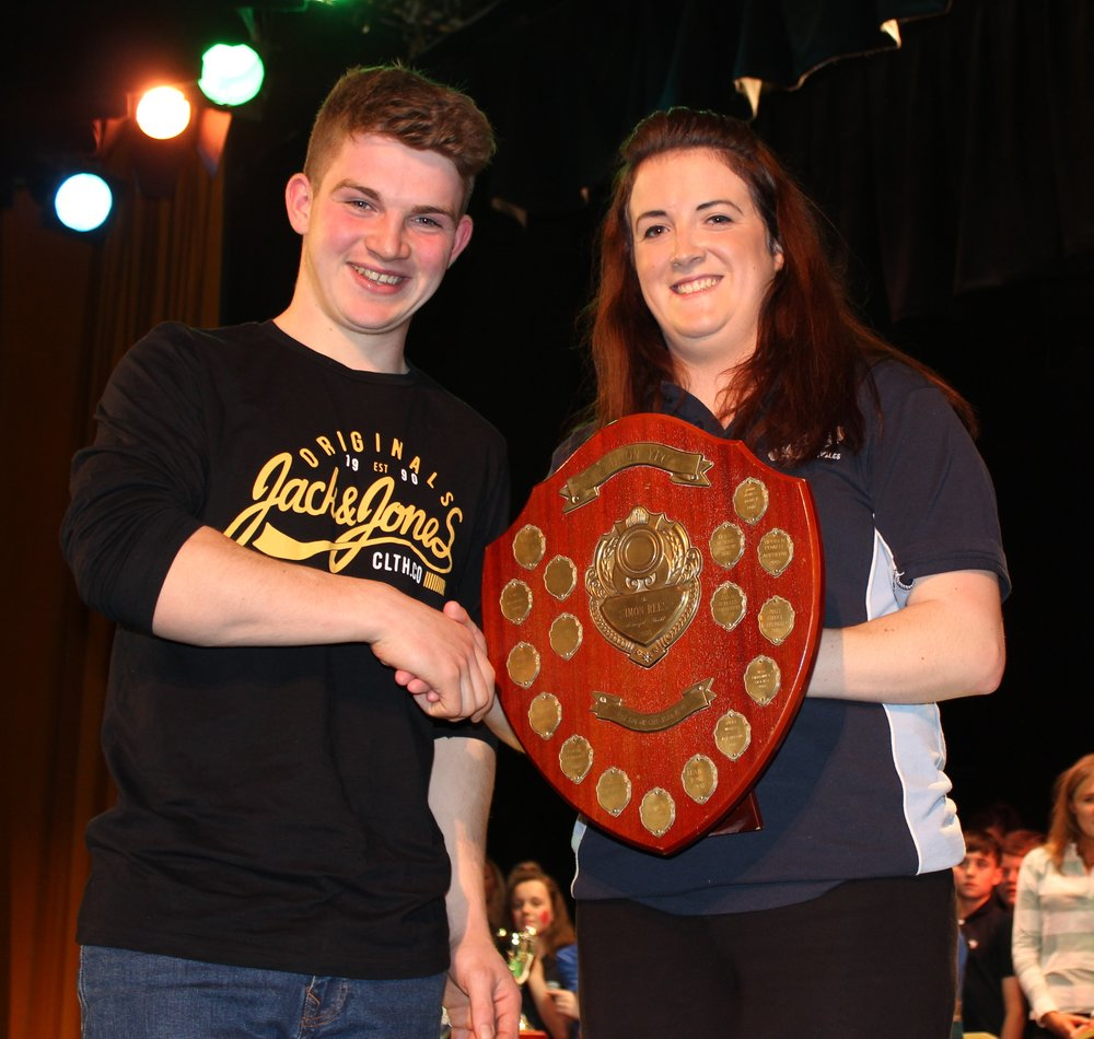 Aeron Powell, Aberedw YFC with Rhayader YFC Club Chairman Ffion Mills - Simon Rees Memorial Cup for Best Performance 17-21 years.