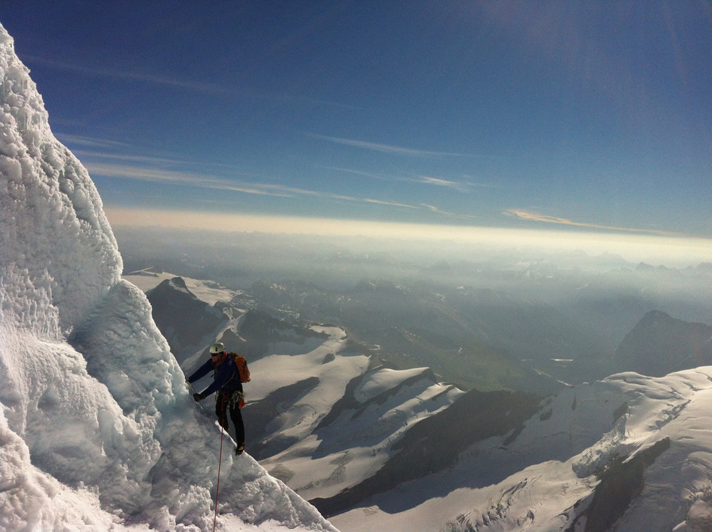 Mark leading through The Roof on Mt. Robson. Photo: Merrie-Beth Board