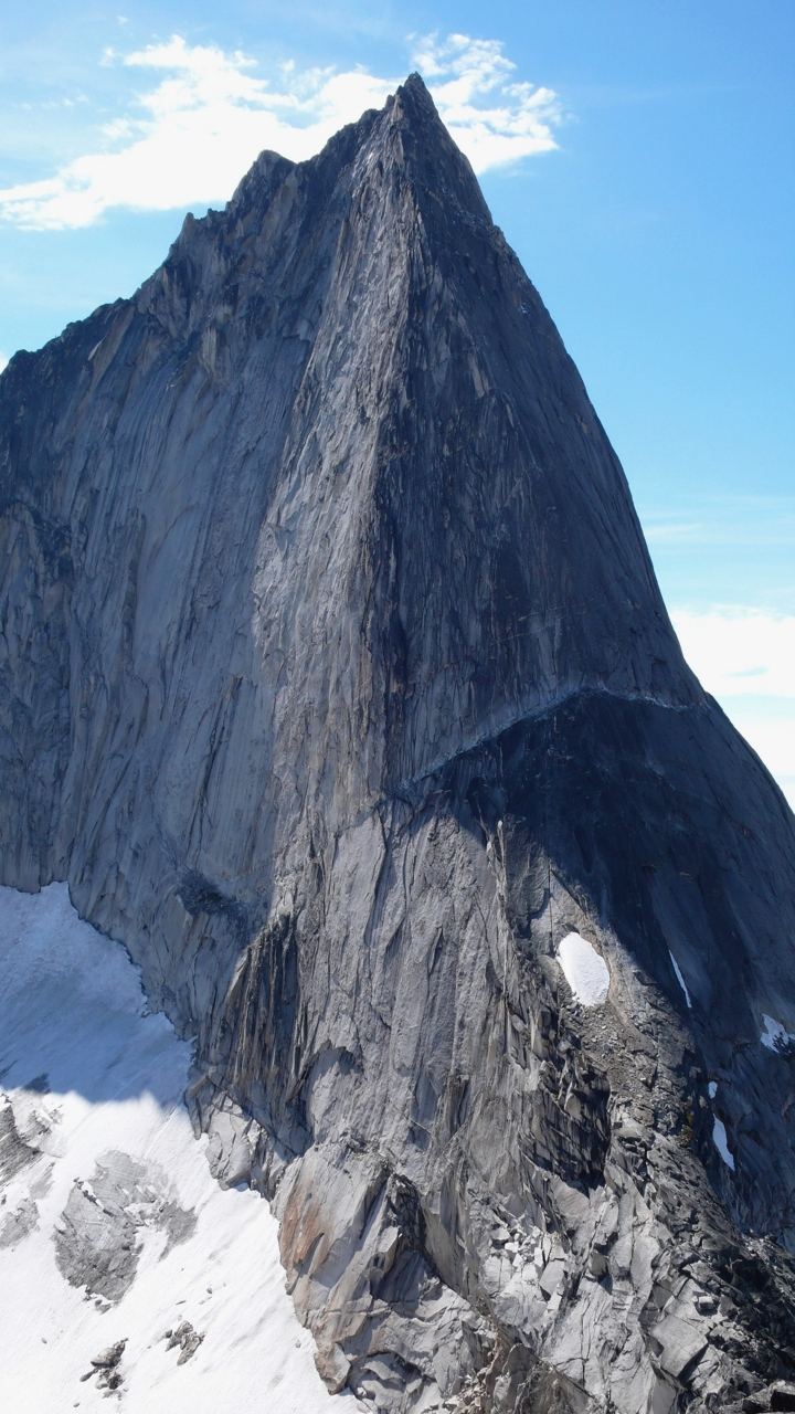 Bugaboo Spire, with the NE Ridge (5.8) facing the camera and the Kain Route (5.6) on the left skyline.