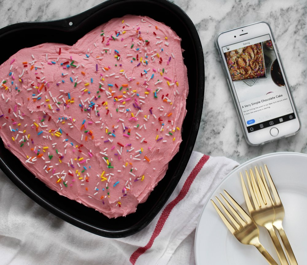 valentines-day-heart-shaped-chocolate-cake-with-pink-frosting-and-sprinkles.JPG