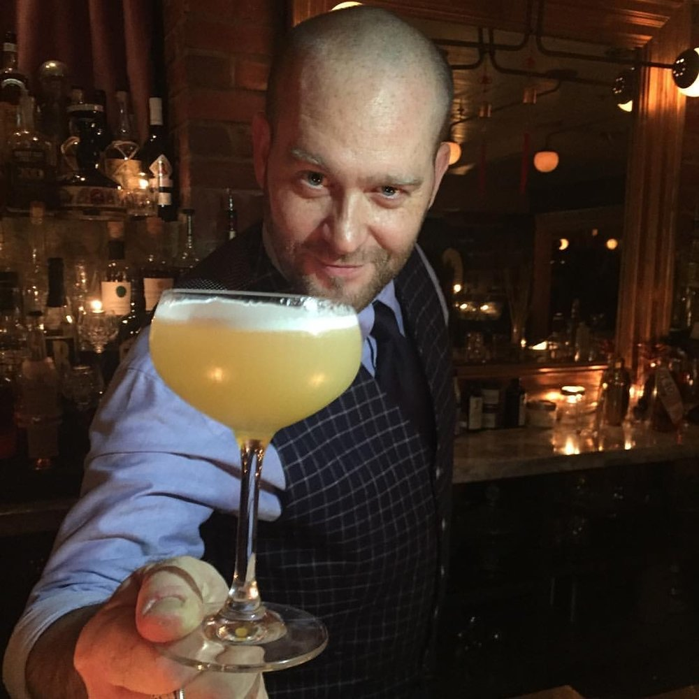 Aaron-Male-serving-a-cocktail-at-the-bar.jpg