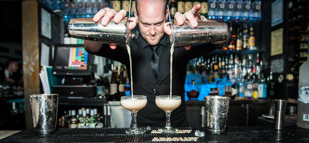 Aaron-Male-mixology-pouring-cocktails-at-the-bar.jpg