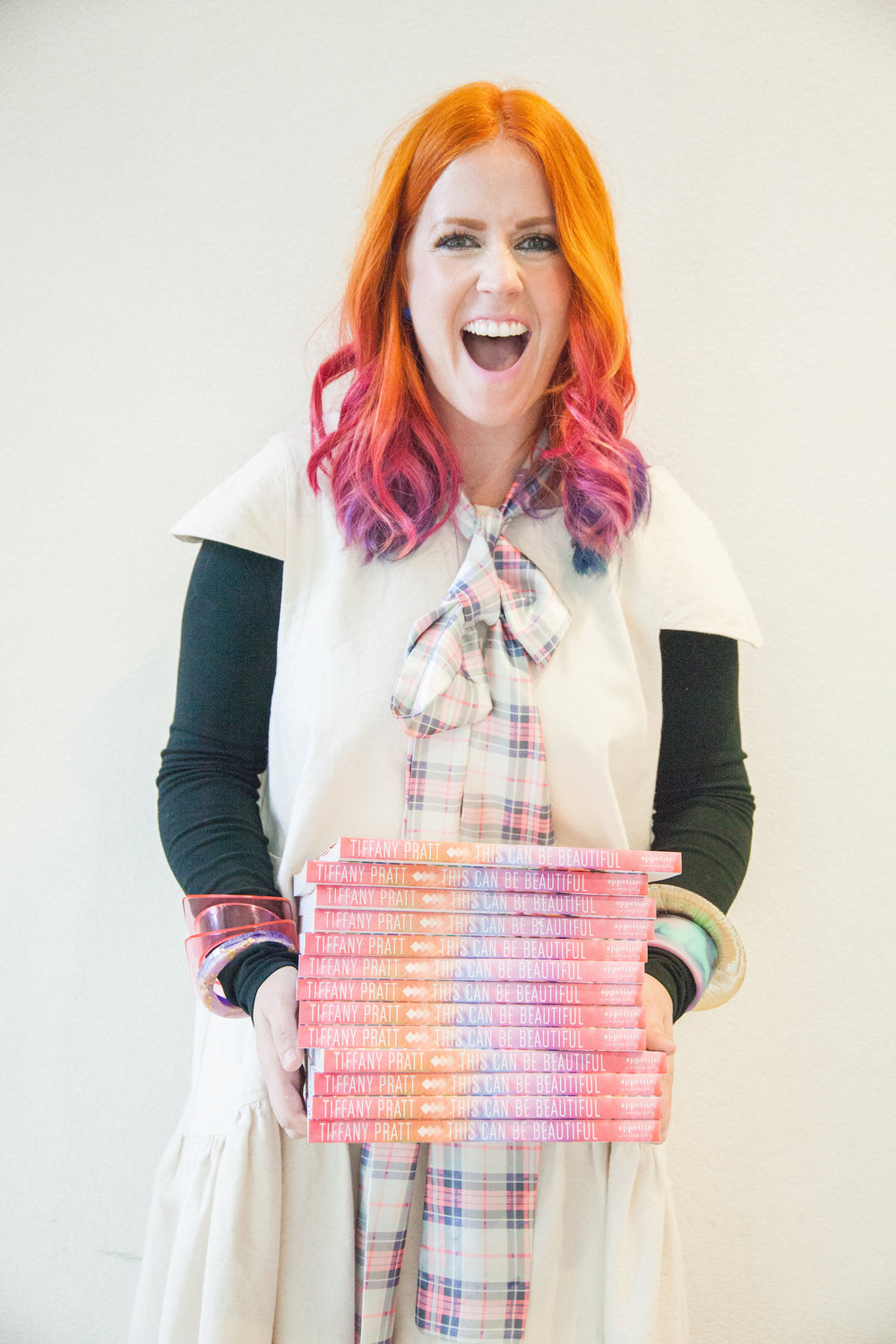 Tiffany-Pratt-holding-stack-of-books-This-Can-Be-Beautiful-at-BlogPodium-LLB-Creative-Gooseberry-Studios.jpg