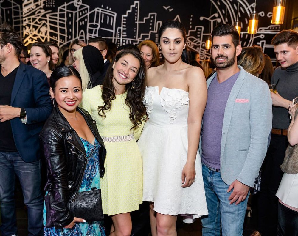 Amira attending a fashion event with her clients