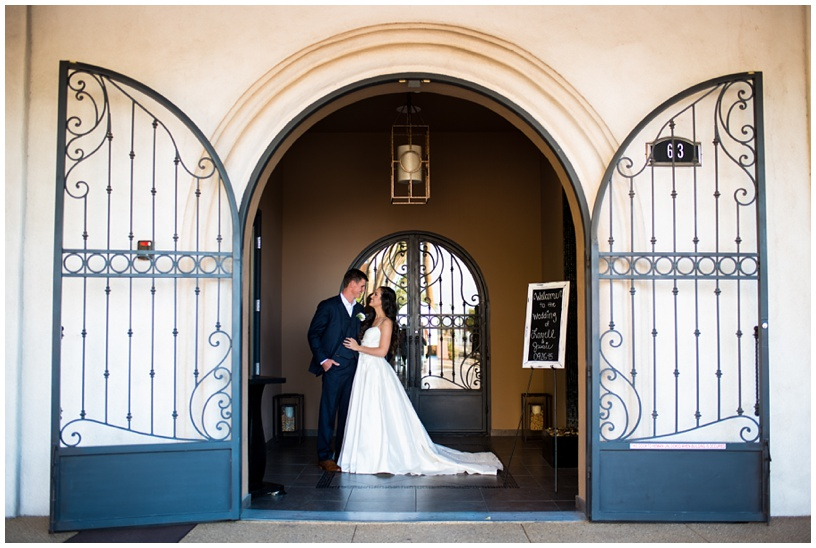 Bride and Groom in front of gates for their wedding at SoHo63 in Chandler, Arizona.