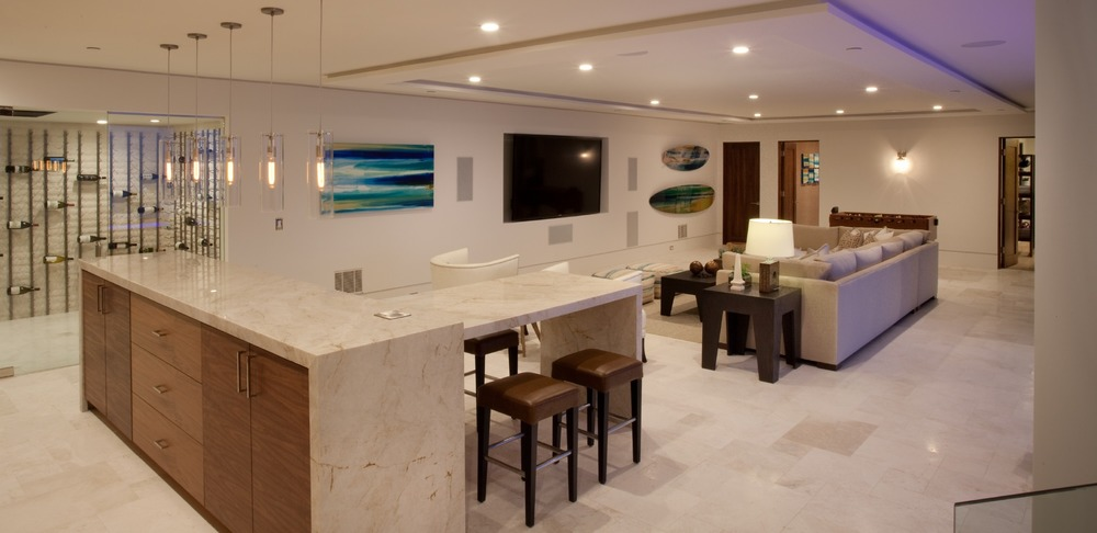 Bottom level with bar, wine cellar, and entertainment area