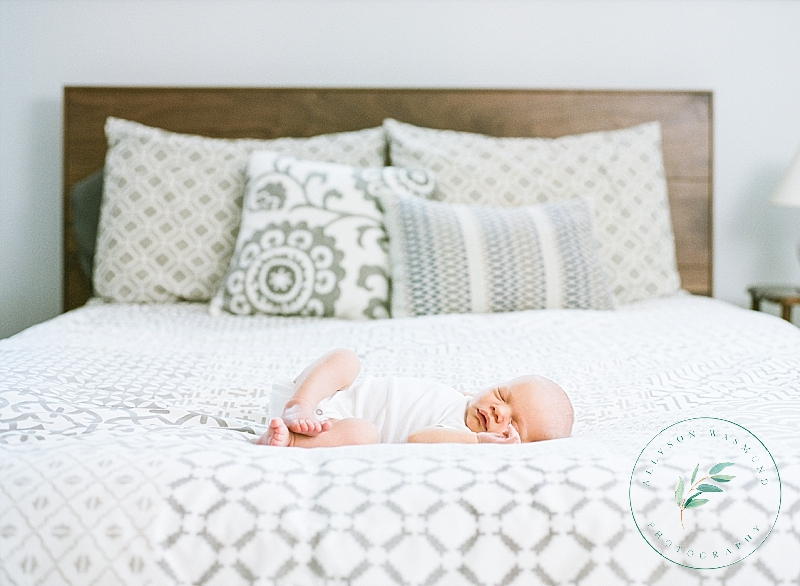 Newborn baby Nels sleeps soundly on a bed during his St. Paul at home newborn portrait session.
