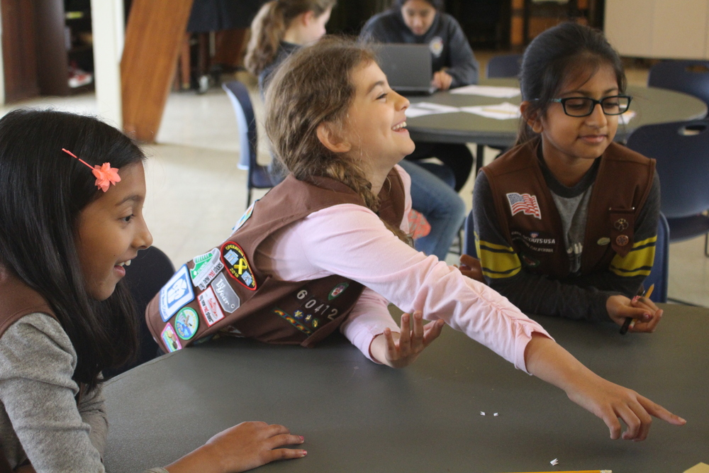Brownies participate in a STEM badge day run by the Space Cookies