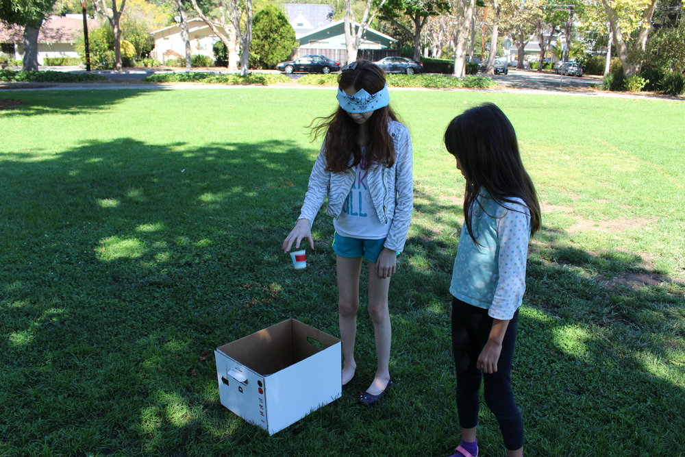 Girls learn about programming by taking turns stepping into a robot's shoes!
