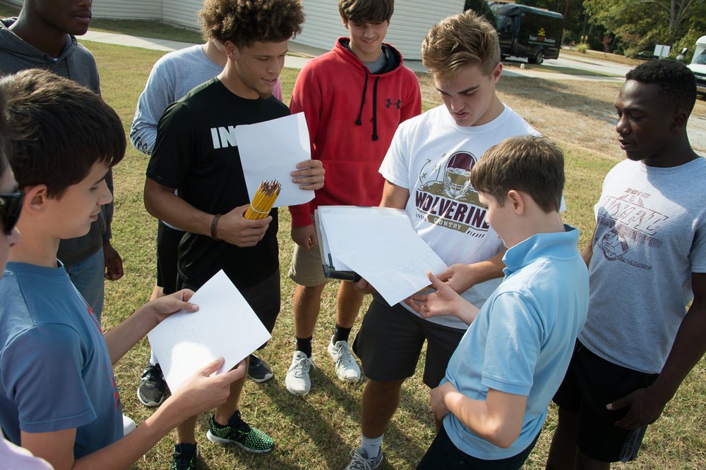 BTG - Middle School - football team - drawing plays.jpg