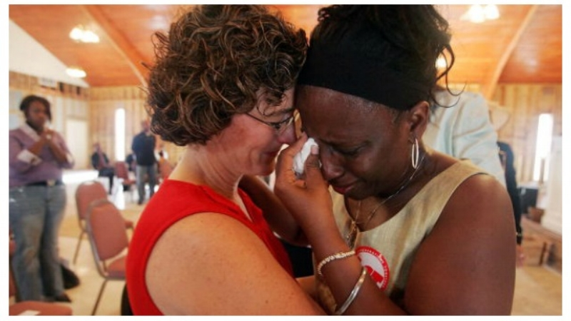 Getty Images In the Lower Ninth Ward of New Orleans, a church volunteer (left) comforts Mary Croom-Fontenot at her Baptist church one year after Katrina.