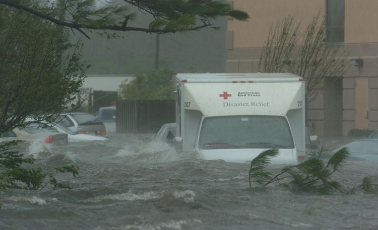 Battered: A Red Cross truck and other vehicles sit flooded in front of a hotel in Pascagoula, Mississippi, as Hurricane Katrina deluges the region, in August, 2005. Credit: AP
