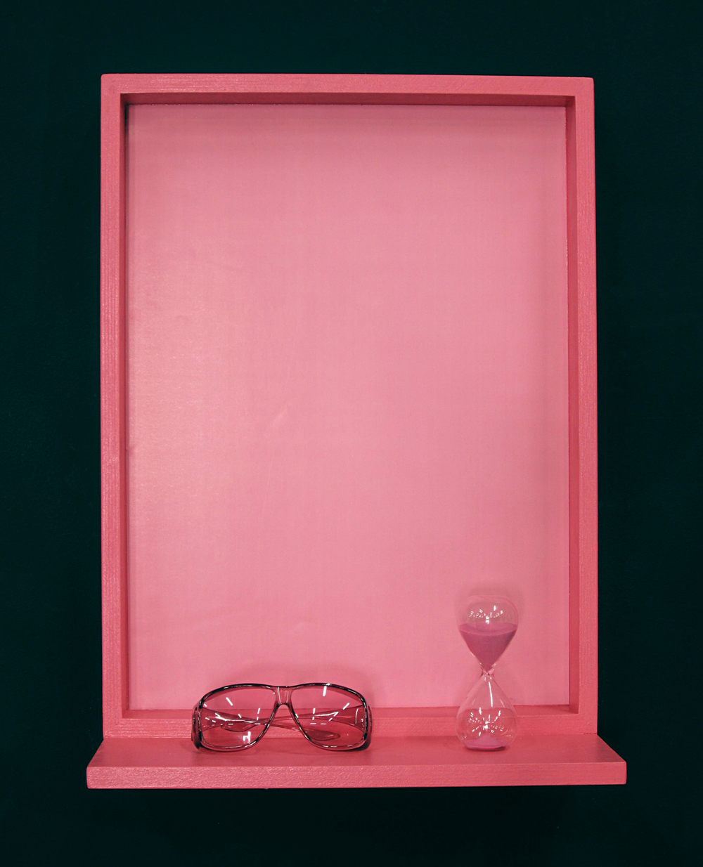 Appetite Apparatus #1 (Baker-Miller Pink, Suppressant)  2011 Wood, paint, color poster, Baker-Miller Pink color therapy glasses, 15 minute sand timer 18X24 inches, duration 15 minutes