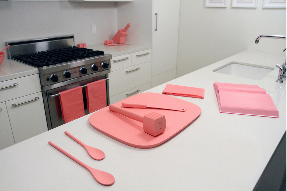 "The Schauss Kitchen  Baker-Miller Pink painted kitchen objects, fabric, Baker-Miller Pink ""cookbook"" Installation dimensions variable Marine Contemporary Art Salon, Venice, CA. 2013 Photo Courtesy of Sean Flaherty"