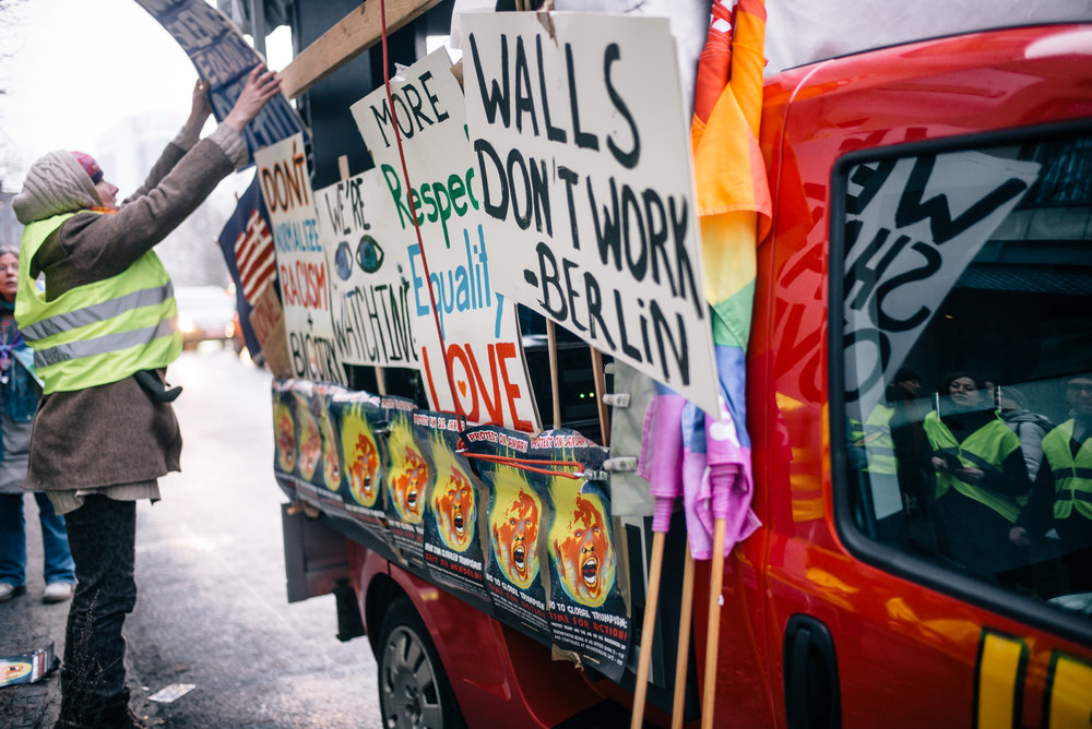 Volunteers from The Coalition Berlin, and other progressive organizations decorate a truck for the rally.
