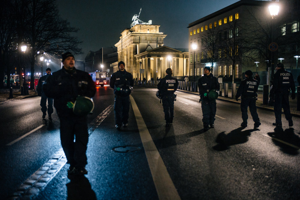 The police escort the demo along the path of the former Berlin Wall.