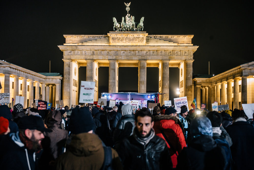 The Brandenburg Gate makes a picturesque backdrop against the hundreds of progressive supporters.
