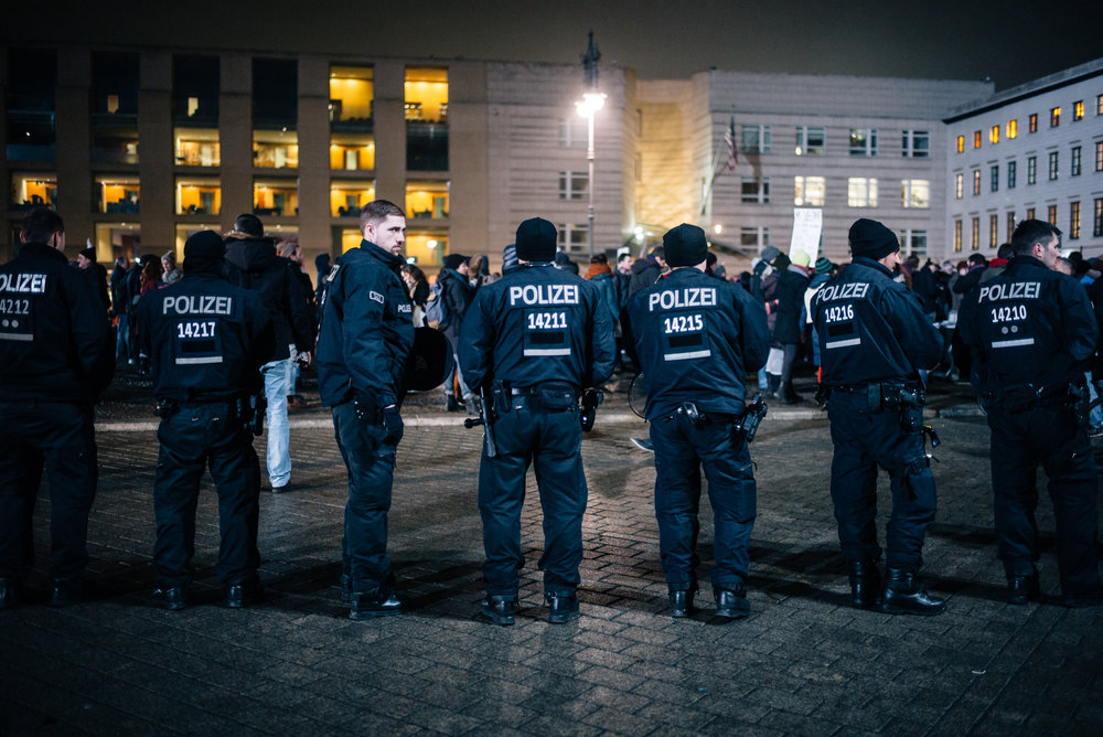 The Berlin police stand around the perimeters of the peaceful, but animated protest.