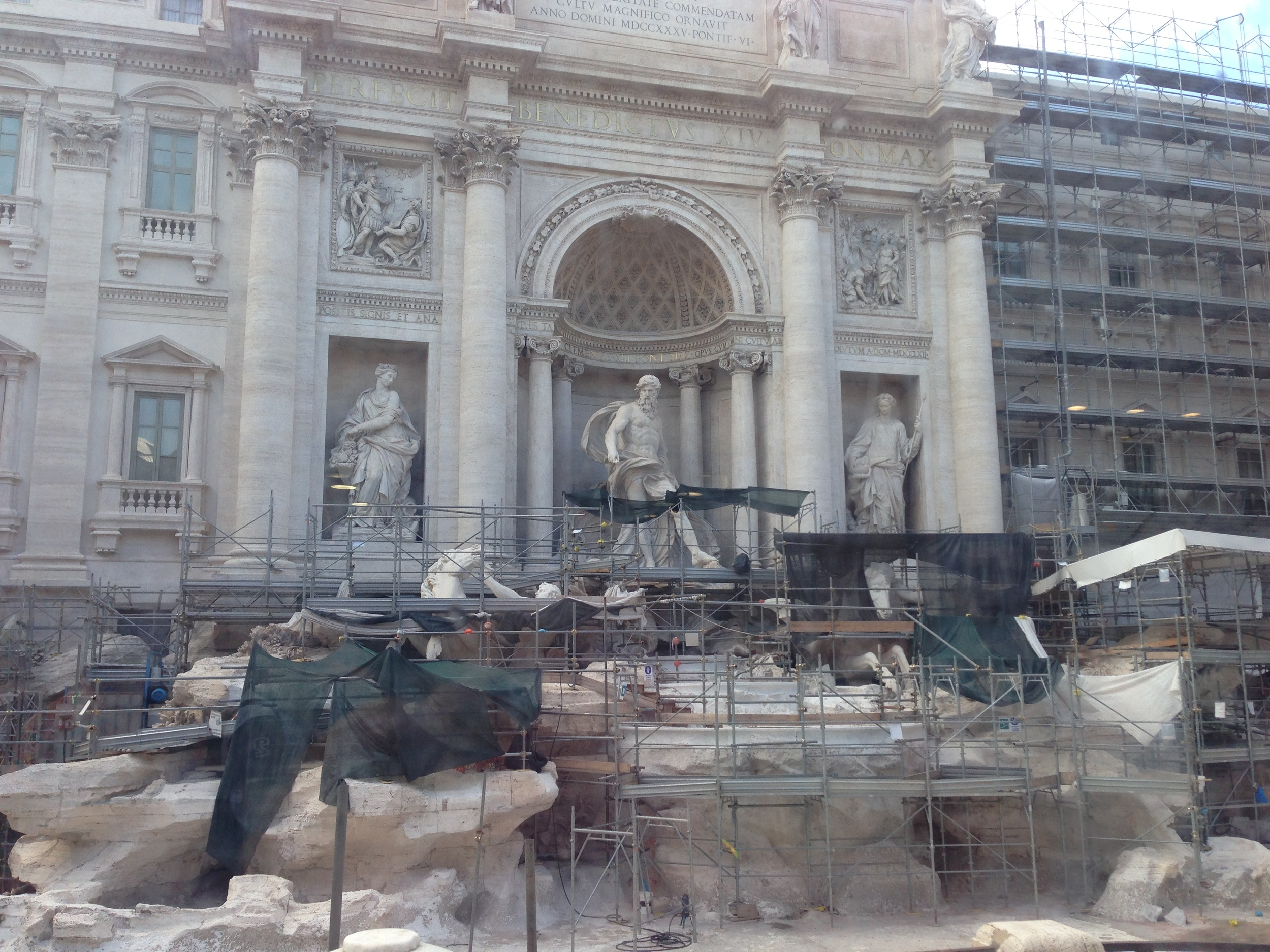 Unfortunately the Trevi Fountain was under renovation...*sigh*  Instead, you could toss you coin into a small puddle situated in front of the plexiglass walls.  We threw it in anyway, wishing for a chance to return some day.