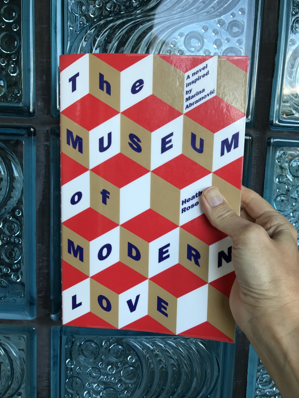 'The Museum Of Modern Love' Blue period: The striking Op Art referencing cover against my architectural Italian glass wall referencing Art Deco and 'Scarface' era Miami. Showing again, that art is in everything. It is in every layer of our lives.