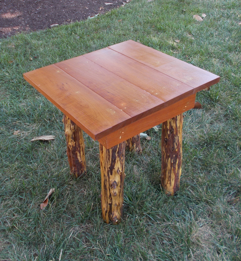 CEDAR LEG TABLE, 21 INCHES HIGH, BY ROBERT LOVE