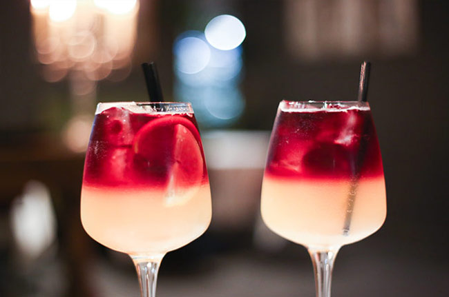Cheers with our pretty Sangria at City Bar, Grand Hotel Central.
